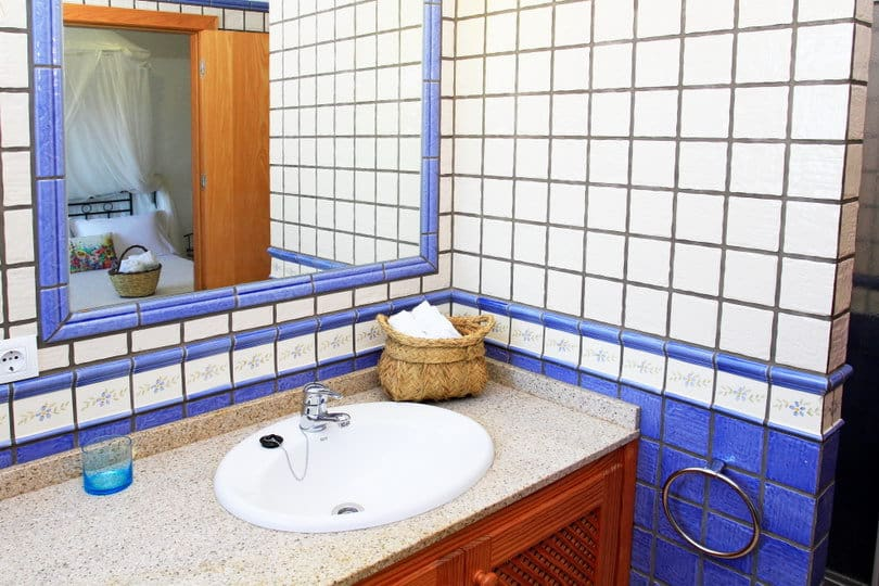 Blue bathroom at sea view ecohouse Opales Yoga retreat Ibiza