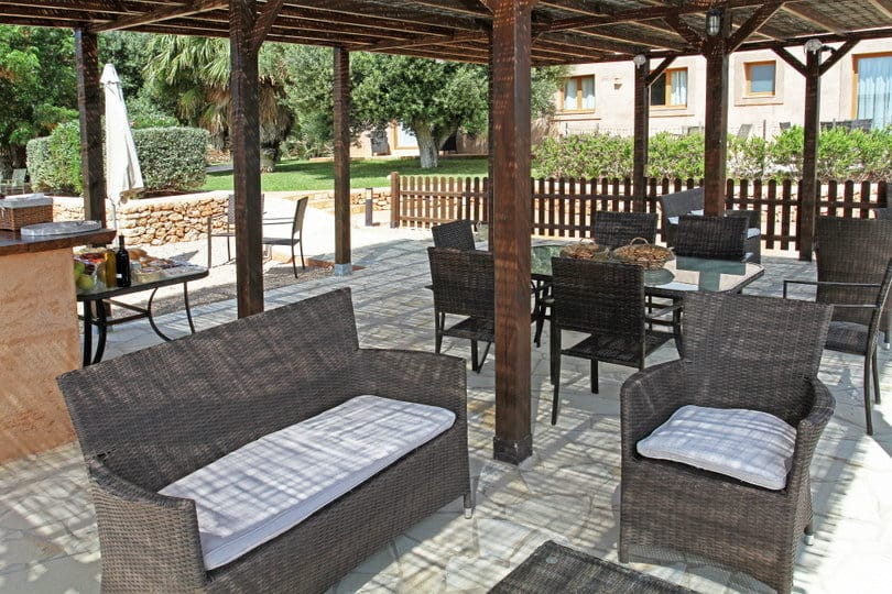 Lovely shadded outdoor dinning room of sea view Ecohouse at Opales Yoga retreat Ibiza