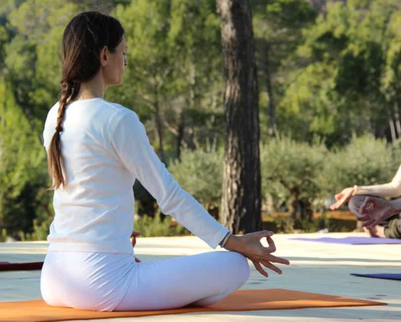 Mindfulness meditation on outdoor Yoga space at Opales Yoga retreat Ibiza