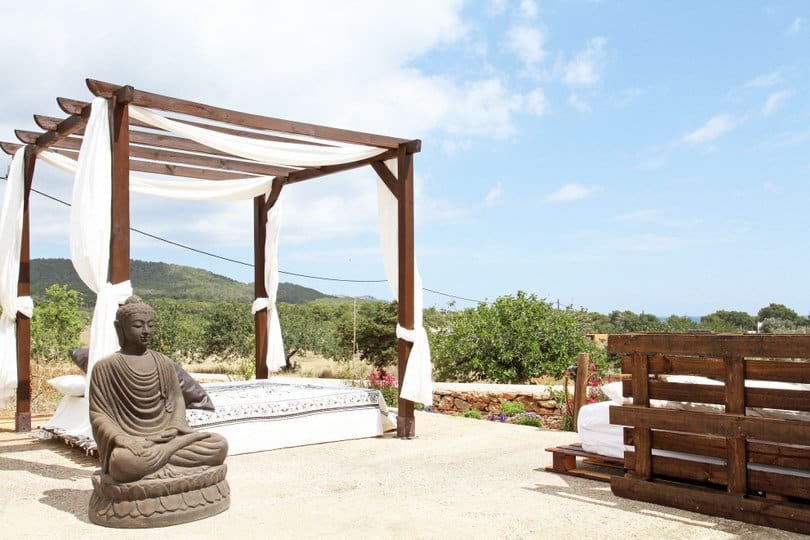 Outdoor chill out with Budha statue at Opales Yoga retreat Ibiza