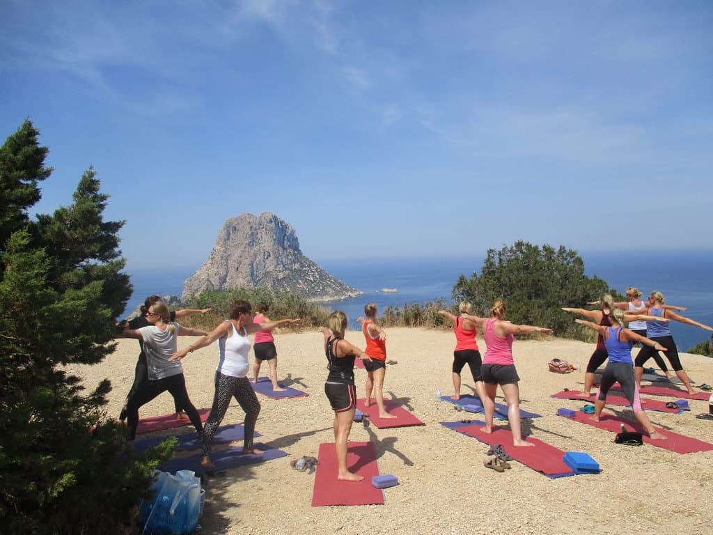 Private Yoga class for hens party with your group of girlfriends in front of Es Vedra Ibiza