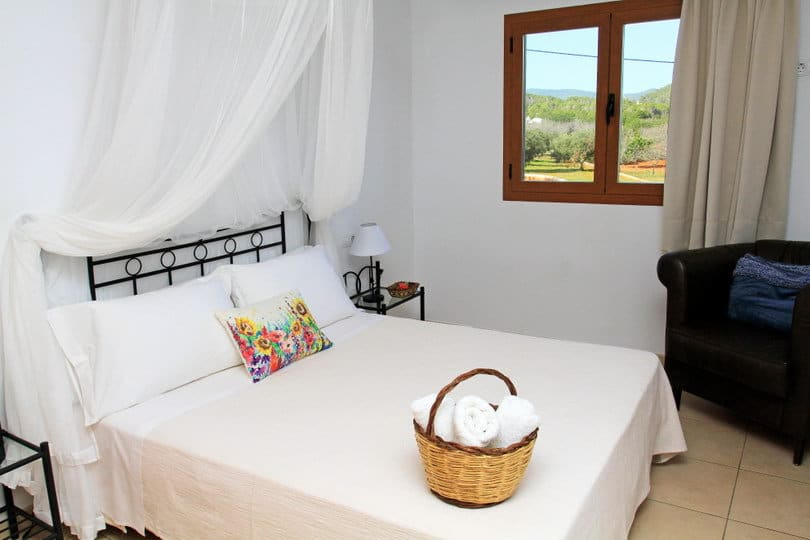 Room with double bed at sea view Eco house Yoga retreat Ibiza