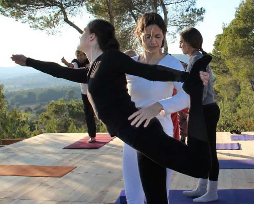 Lord Shiva dancers pose adjusted by Opale during Yoga retreat in Ibiza