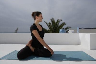 Opale in Bharadvajasana for Decathlon photo shoot in Ibiza