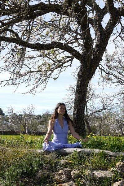 Opale in Meditation below a tree in Ibiza