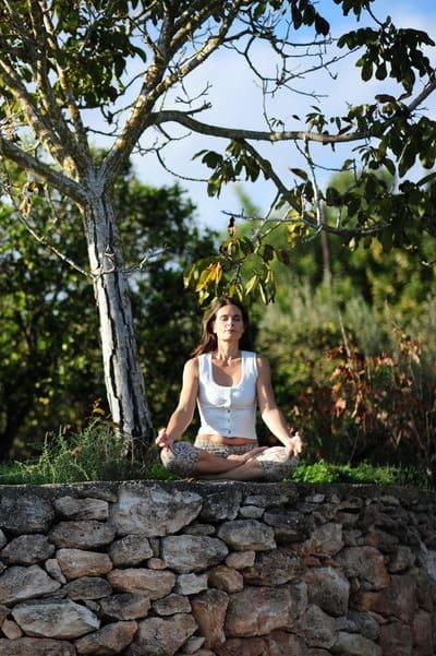 Opale in Meditation by a tree in Ibiza