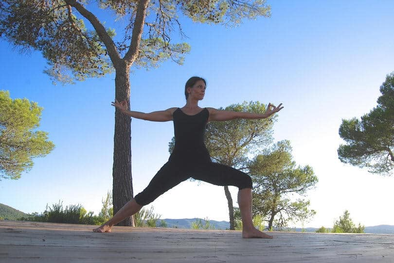 Opale in Virabhadrasana 2 warrior pose Yoga retreat Ibiza