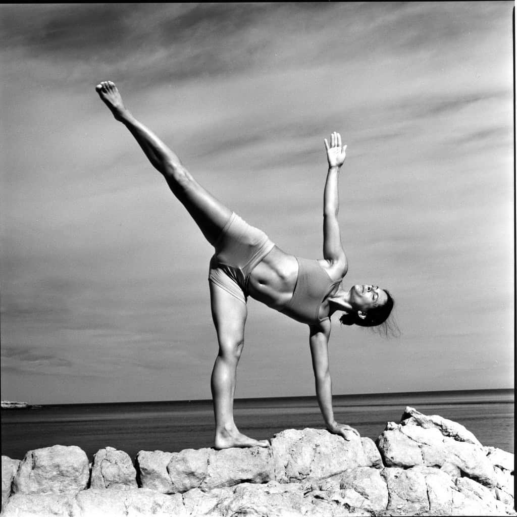Opale in ardha candrasana Ashtanga Yoga photo shoot by Jerome Ferriere in Ibiza 2006