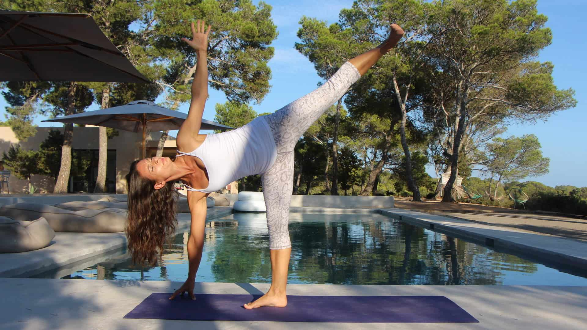 Opale in ardha candrasana or half moon pose at private Yoga lesson in Ibiza