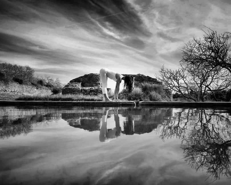 Opale in ardha uttanasana in Ibiza black white by Gato Suarez