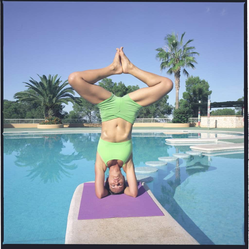 Opale in baddha konasana sirsasana Ashtanga Yoga photo shoot by Jerome Ferriere in Ibiza