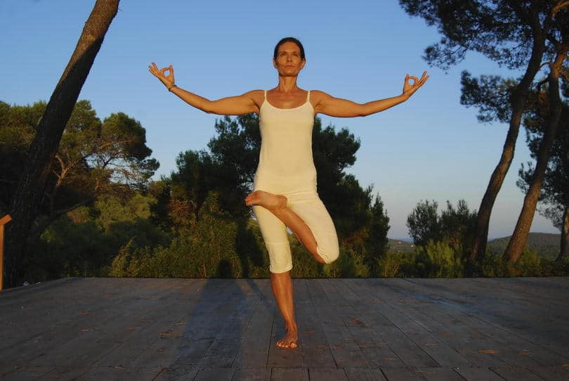 Opale in balancing pose at yoga retreat in Ibiza