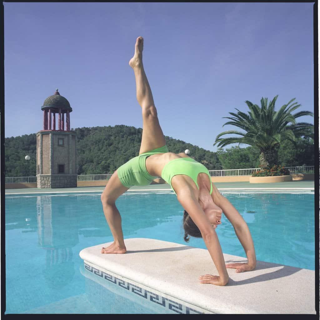 Opale in eka pada urdhva dhanurasana Ashtanga Yoga photo shoot by Jerome Ferriere in Ibiza