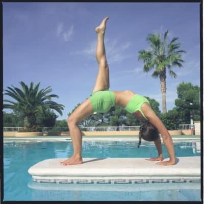 Opale in eka pada urdhva dhanurasana side Ashtanga Yoga photo shoot by Jerome Ferriere in Ibiza