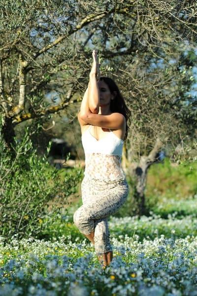 Opale in garudasana eagle pose Hatha Yoga Ibiza
