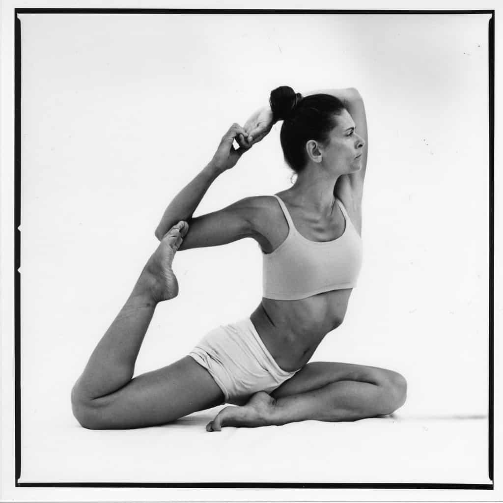 Opale in naginyasana Ashtanga Yoga photo shoot by Jerome Ferriere in Ibiza 2006