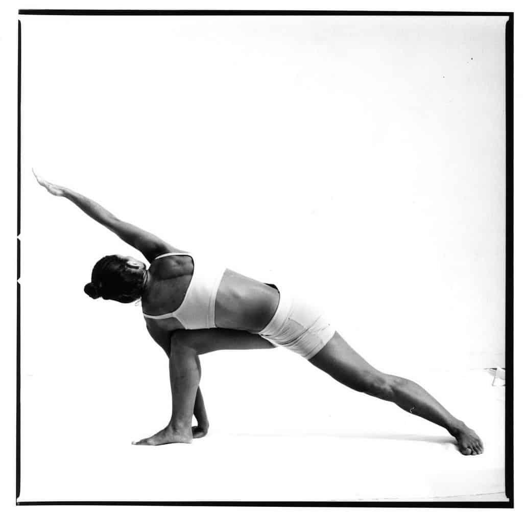 Opale in parivrtta parsvakonasana Ashtanga Yoga photo shoot by Jerome Ferriere in Ibiza 2006