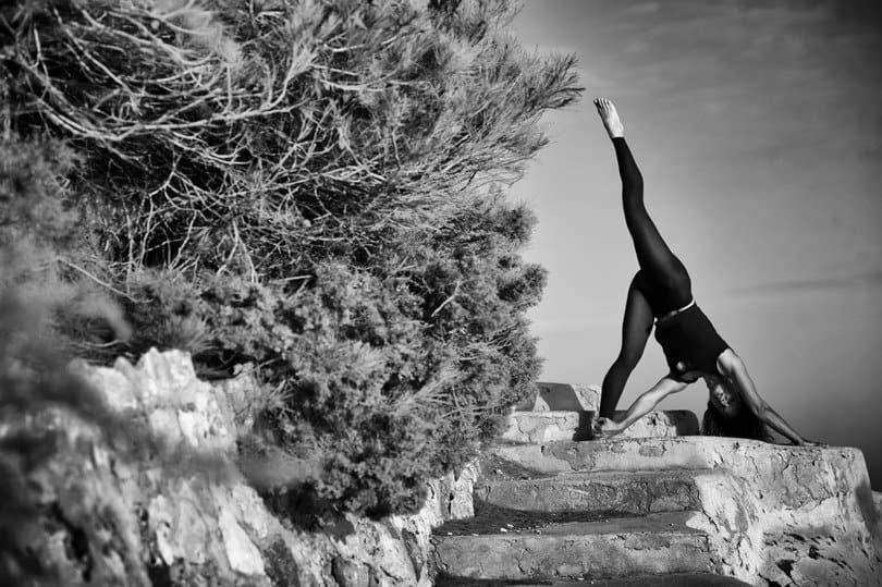 Opale in parivrttaikapada adho mukha svanasana black white in Ibiza by Gato Suarez