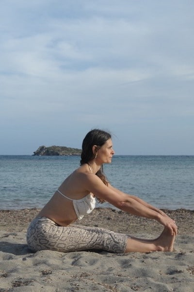 Opale in pascimottanasana preparation on the beach Hatha Yoga Ibiza