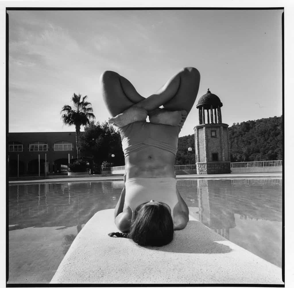 Opale in urdhva padmasana in sarvangasana Ashtanga Yoga photo shoot by Jerome Ferriere in Ibiza 2006