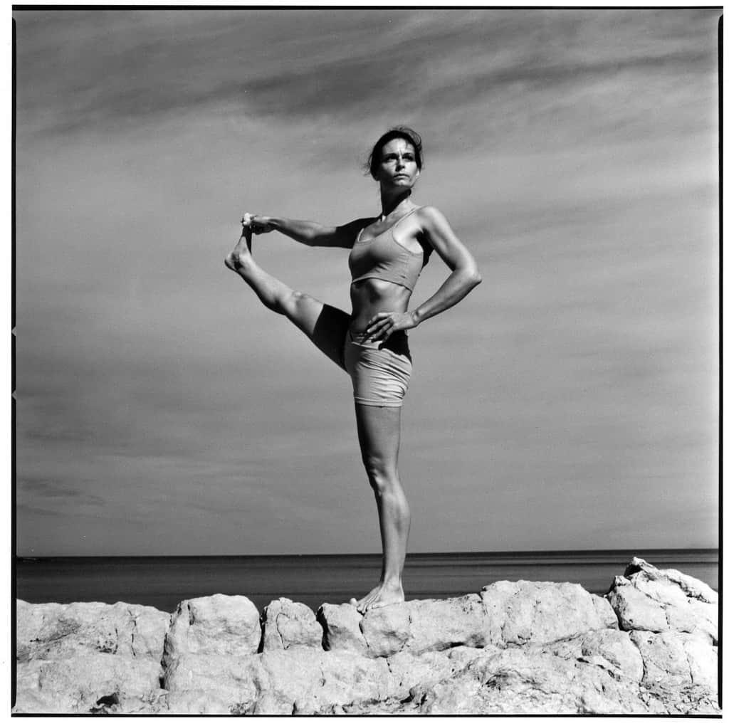 Opale in utthita hasta padangusthasana Ashtanga Yoga photo shoot by Jerome Ferriere in Ibiza 2006