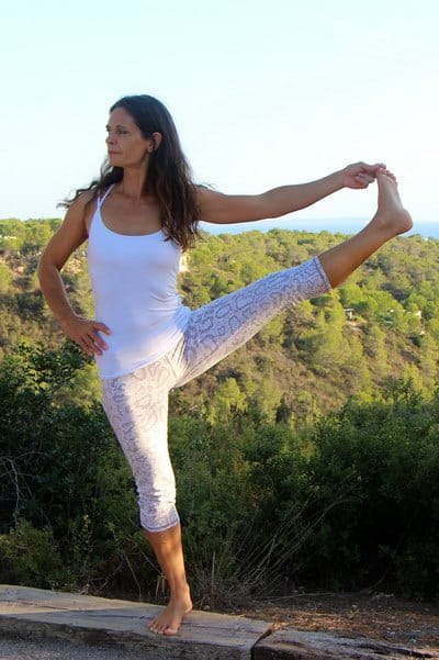 Opale in utthita hasta padangusthasana for Yoga retreat at sea view ecohouse Ibiza