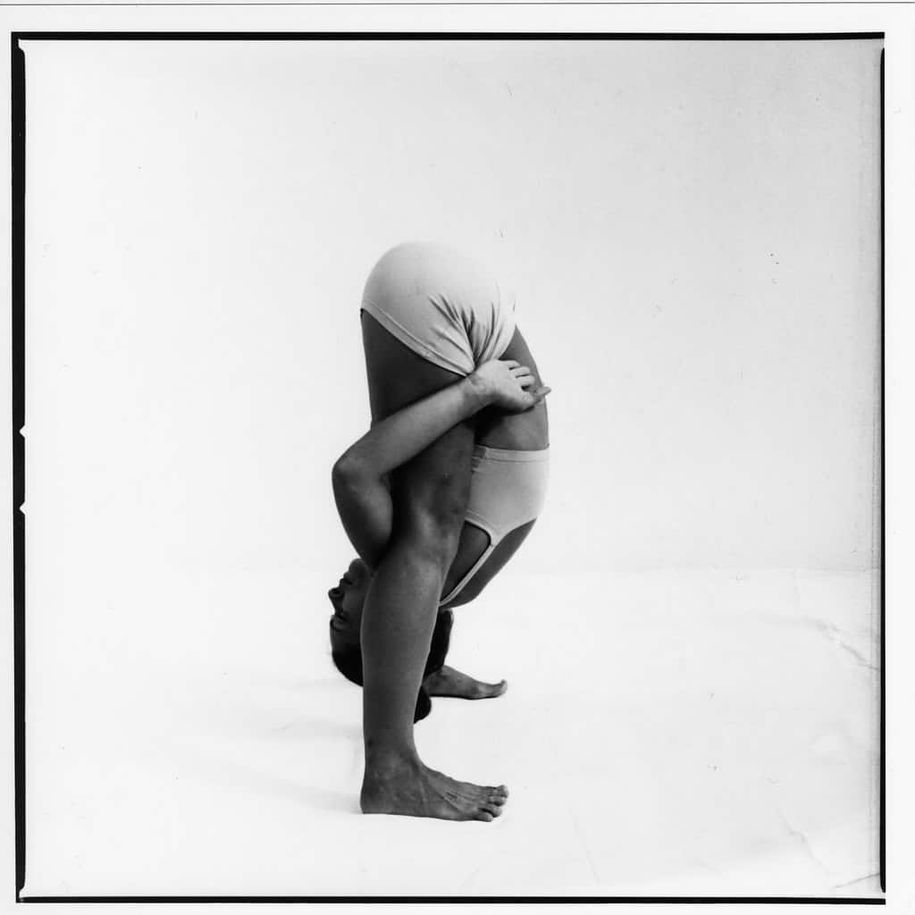 Opale in utthita tittibhasana Ashtanga Yoga photo shoot by Jerome Ferriere in Ibiza 2006