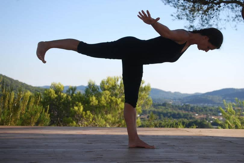 Opale in variation of Virabhadrasana 3 Yoga retreat Ibiza