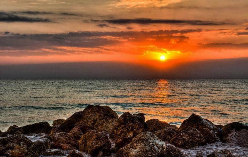 Rocks by the sea at sunset Ibiza