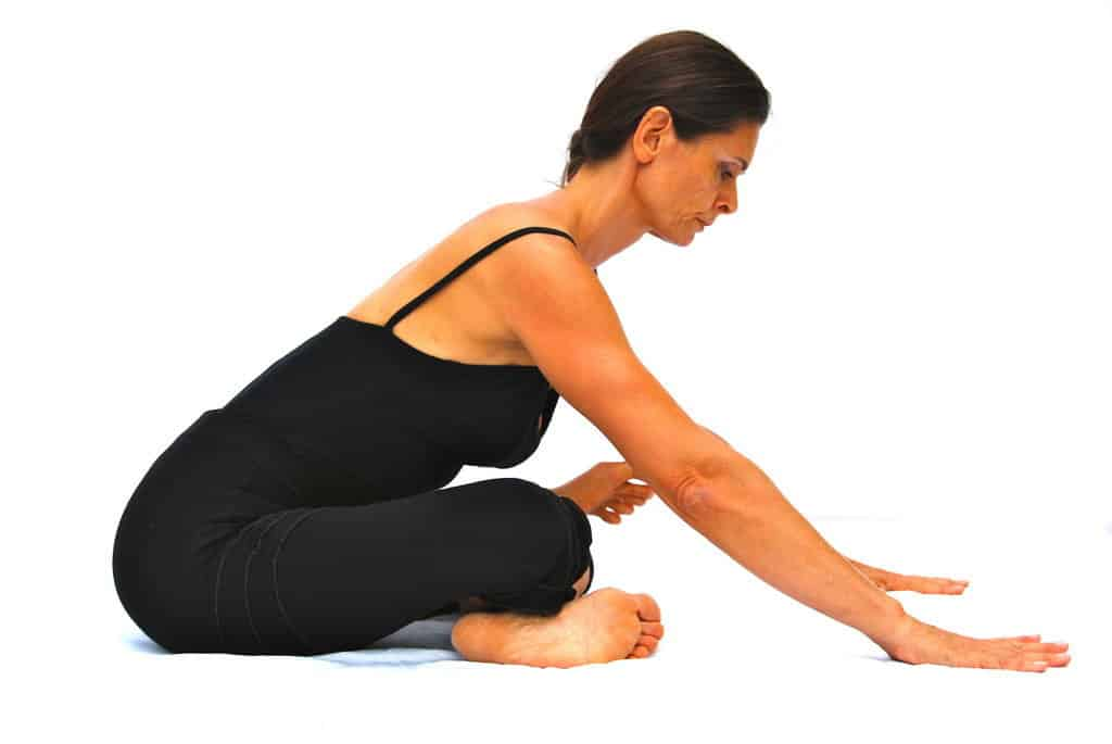 Agnistambhasana fire log pose bowed forward Opale Yoga Ibiza