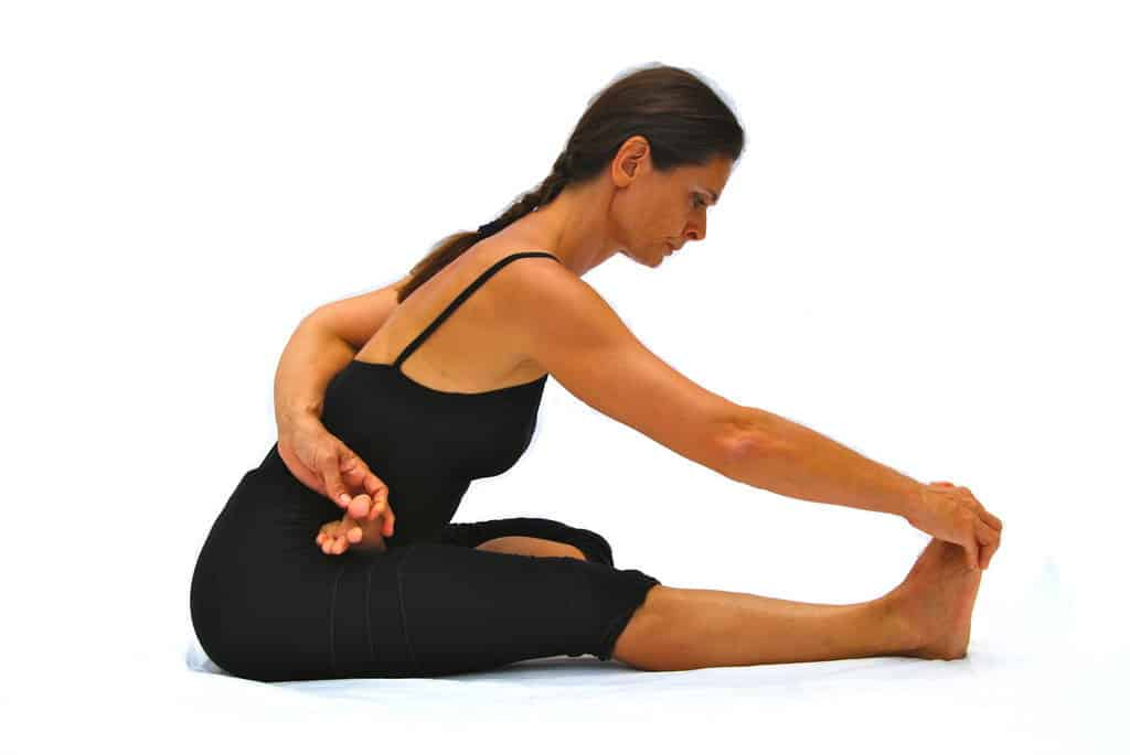 Ardha baddha padma pascimottanasana 1 leg in half lotus back stretched out pose preparation Opale Yoga Ibiza