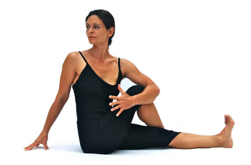 Ardha matsyendrasana I half Matsyendras pose preparation with extended leg Opale Yoga Ibiza