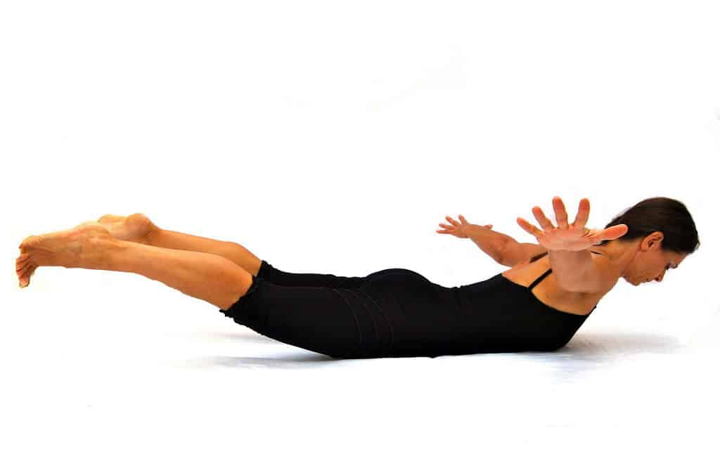 Back body strengthening with both arms legs Opale Pilates Ibiza