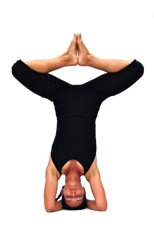 Baddha konasana in sirsasana bound angle pose in headstand Opale Yoga Ibiza