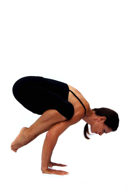 Bakasana crow pose preparation for crane pose arm balance Opale Yoga Ibiza