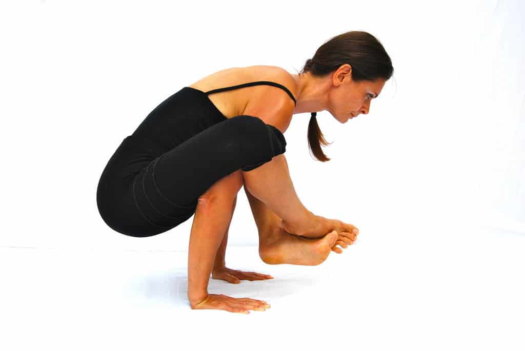 Bhujapidanasana arm pressure pose arm balance Opale Yoga Ibiza