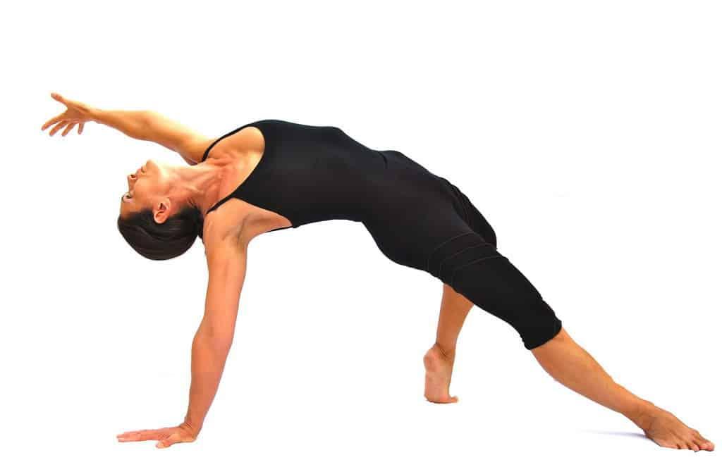 Camatkarasana wild thing pose Opale Yoga Ibiza