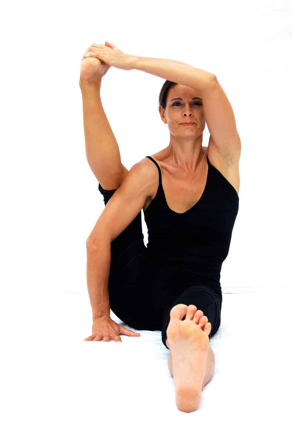 Eka pada sirsasana preparation one foot behing the head pose Opale Yoga Ibiza
