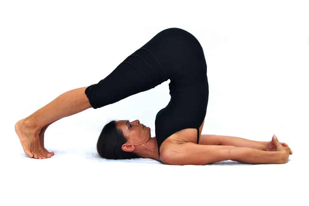 Halasana plow pose Opale Yoga Ibiza
