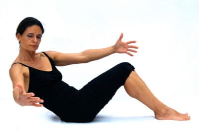 Half roll back with obliques Opale Pilates Ibiza