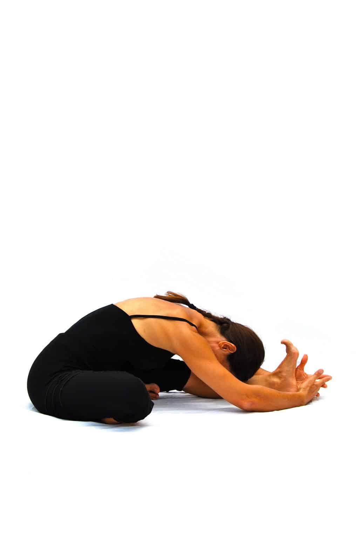 Janu sirsasana head to knee pose Opale Yoga Ibiza