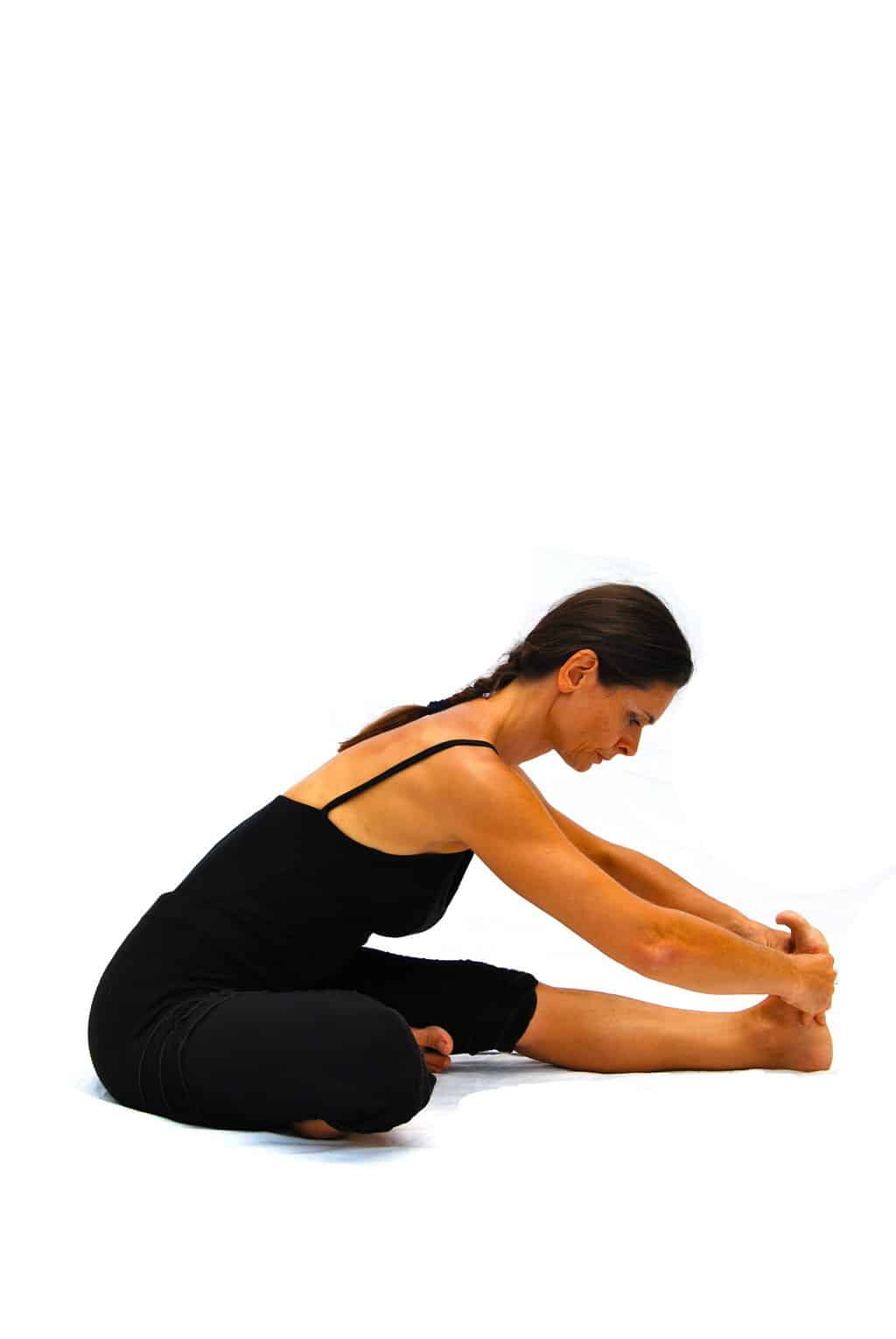 Janu sirsasana preparation head to knee pose Opale Yoga Ibiza
