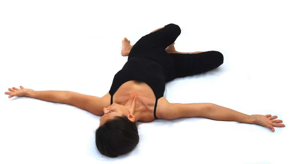 Jathara parivartanasana firmly rotated pose preparation Opale Yoga Ibiza