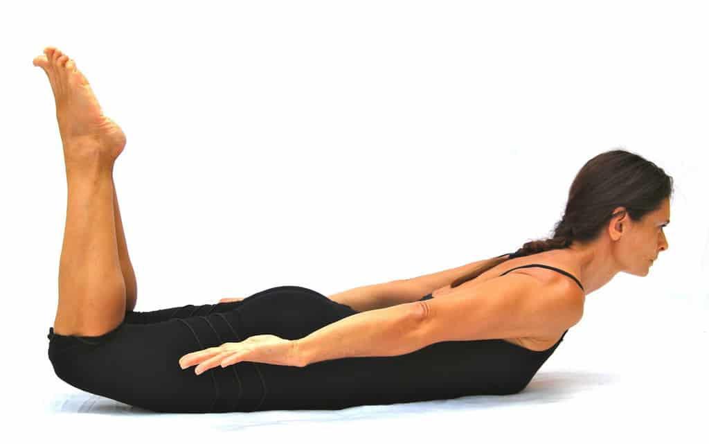 Makarasana locust pose with bent knees Opale Yoga Ibiza