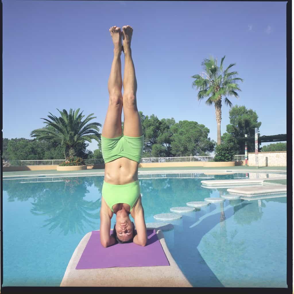 Opale in sirsasana Ashtanga Yoga photo shoot by Jerome Ferriere in Ibiza