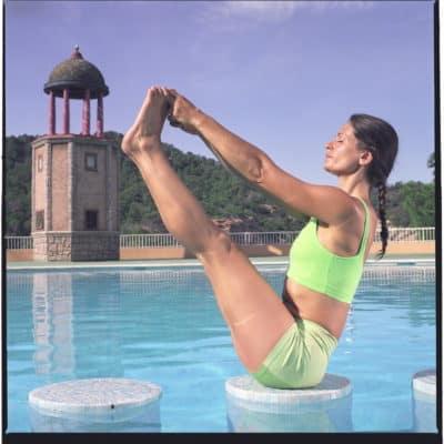 Opale in urdhva mukha pascimottanasana Ashtanga Yoga photo shoot by Jerome Ferriere in Ibiza