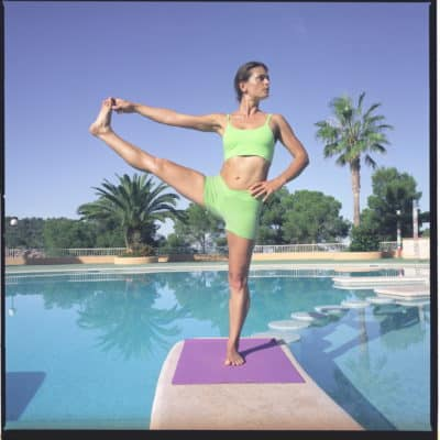 Opale in utthita hasta padangusthasana Ashtanga Yoga photo shoot by Jerome Ferriere in Ibiza