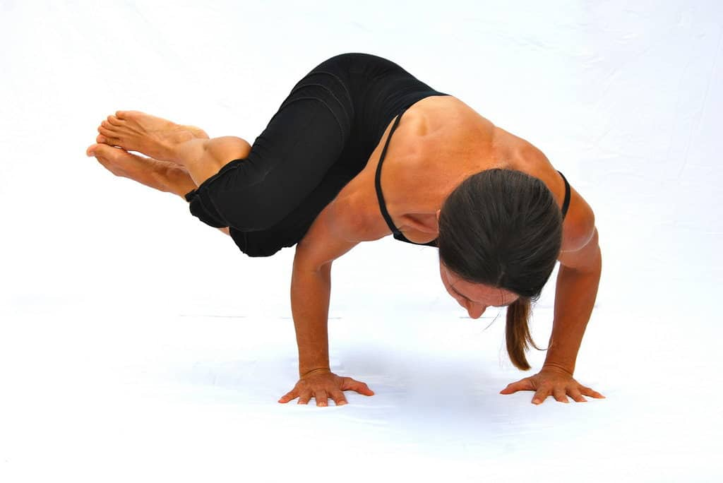 Parivrtta bakasana side crow pose arm balance Opale Yoga Ibiza