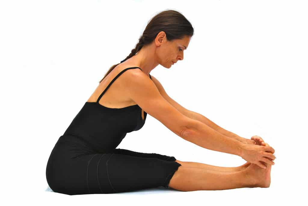 Pascimottanasana back stretched out pose preparation Opale Yoga Ibiza