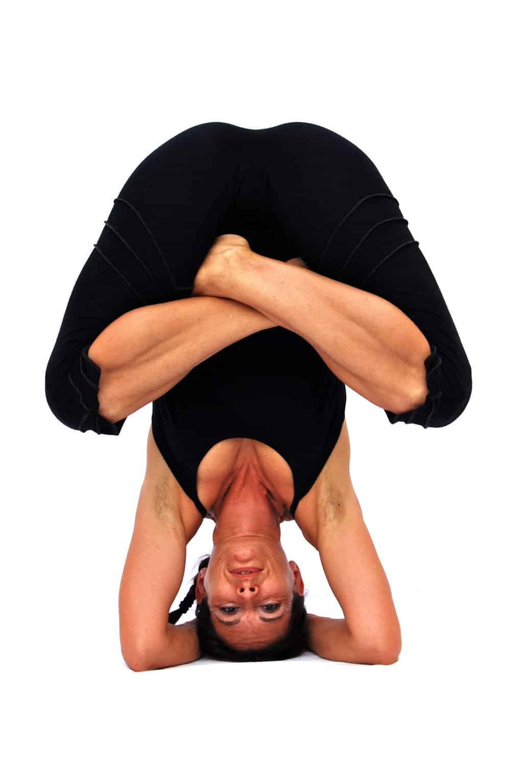 Pindasana in sirsasana embryo pose in headstand Opale Yoga Ibiza
